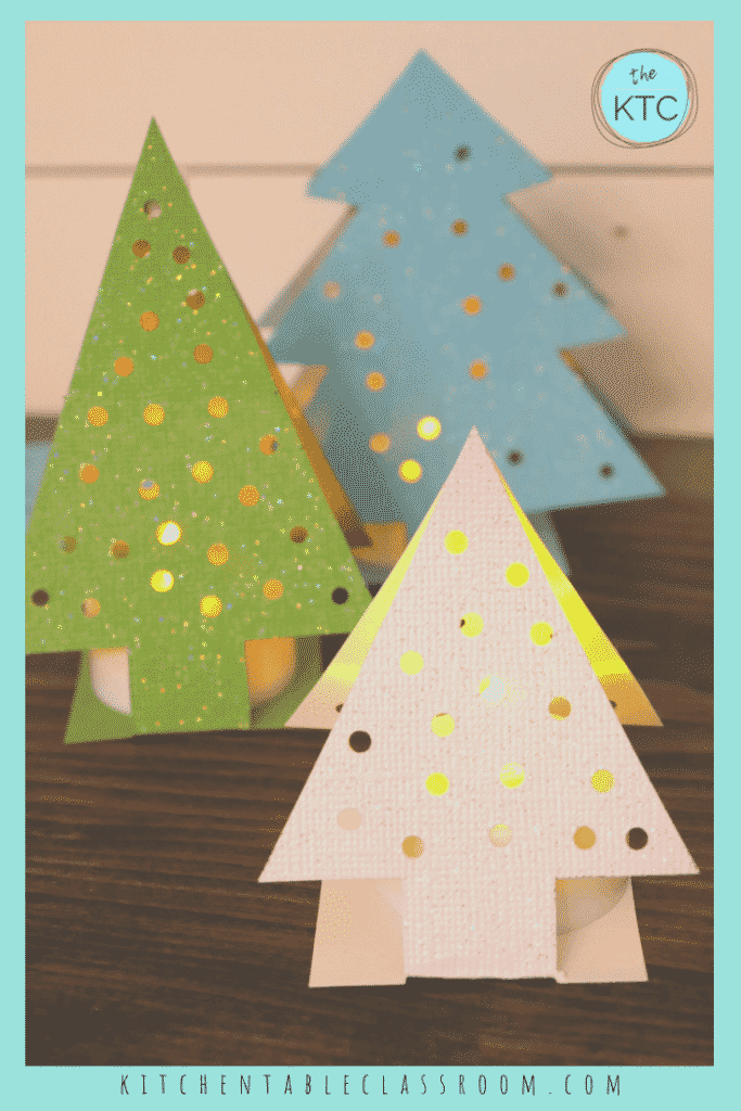 Best Christmas Paper Crafts featured by top Seattle lifestyle blogger, Marcie in Mommyland: These paper Christmas tree ornaments come together quickly with just card stock! This easy Christmas craft for kid is perfect on the mantle or holiday table