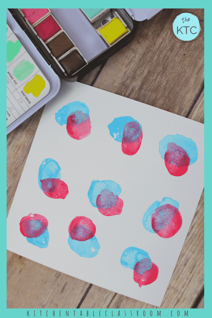 red and blue watercolor circles overlap to create purple