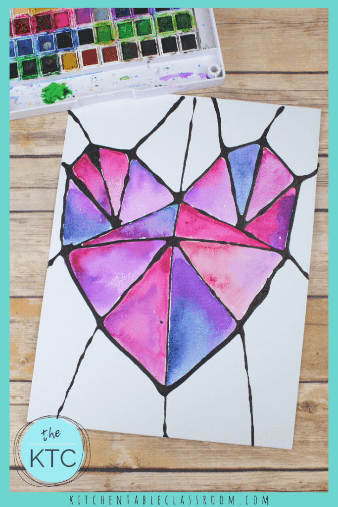 geometric heart drawing with black glue and painted with cool colored watercolors