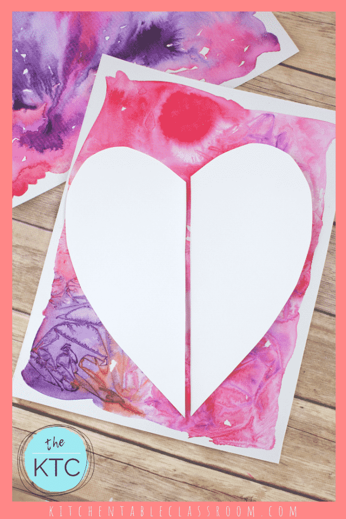 two half heart shapes on watercolor pink and purple background