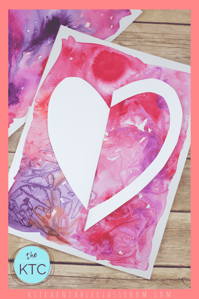 cut paper heart shape with watercolor background