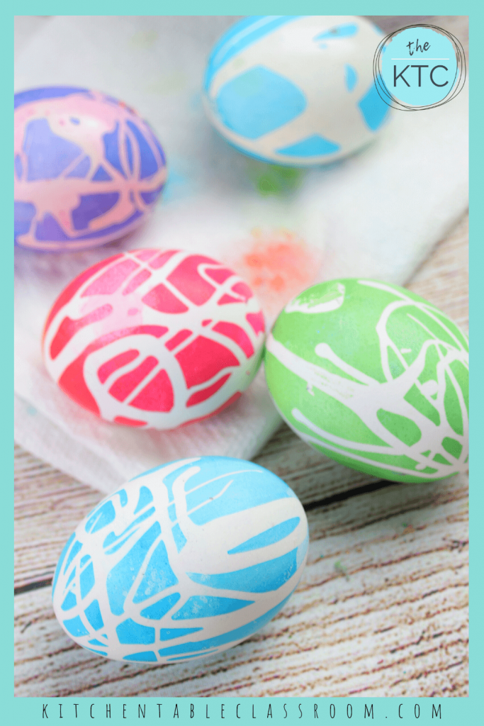 blue, green, red, and purple Easter eggs decorated with lines of rubber cement