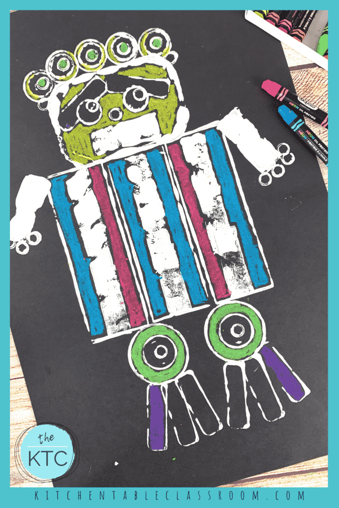 Robot prints use white paint on black paper with oil pastel for. splash of color