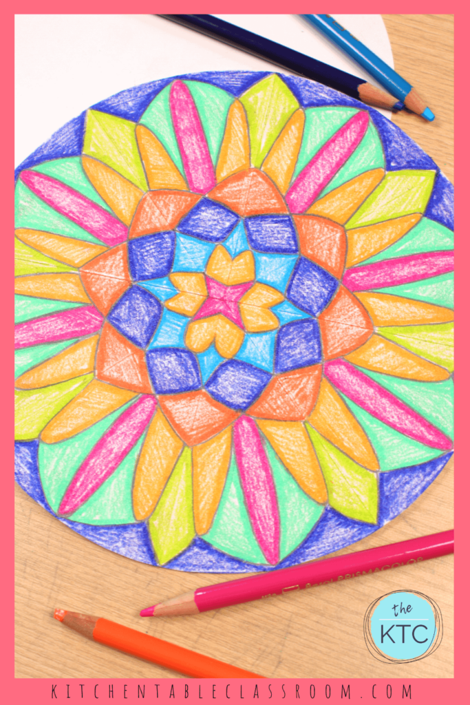 Color your DIY mandala with colored pencils for a finished drawing.